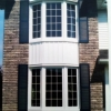 stacked bay windows with internal grilles