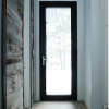 Hinged Entry with triple glazing and brushed nickel lever handle