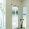 Laminated glass, multipoint locks and full compression seals - this is a seriously strong entry.  European surface-mounted hinges carry it perfectly